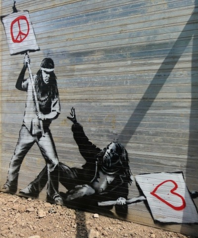 Peace, love and understanding? - by Banksy