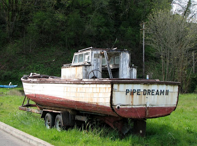 Pipe Dream II - A boat by the side of the road
