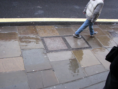 Walking on The High Street, Oxford, England, in the Rain