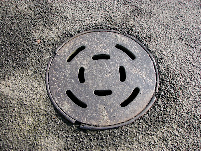 Metal cover on the street, Astoria, Oregon