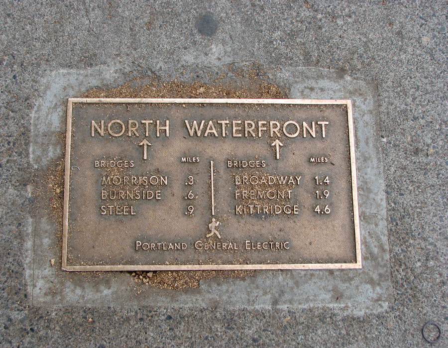 Plaque in the pavement showing distances to bridges on the Willamette River