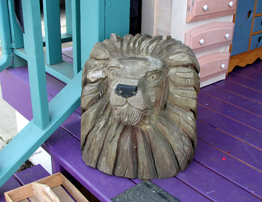 Wood sculpture of a lion's head