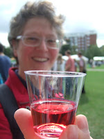 Lola I holding a sample of wine