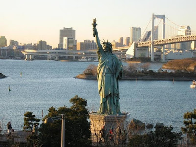 statue of liberty torch balcony. Liberty holds a gilt torch