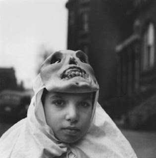 Untitled (boy with mask atop head)