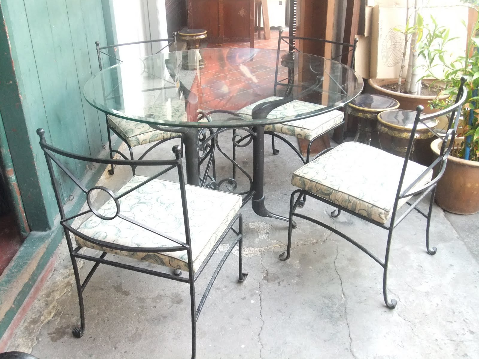 Truly retro truly vintage ashley furniture for Cast iron and glass dining table