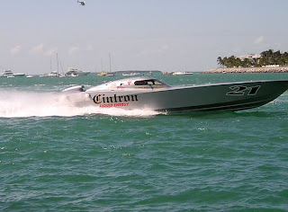 Modern powerboat racer flying into the harbor