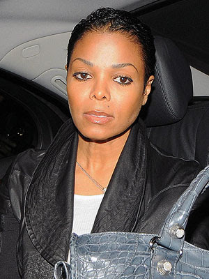 ... came across this picture of Janet Jackson's new hair cut and I LOVE IT!