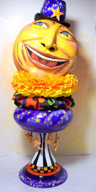 Mister moon- paper clay on gourd with wooden stand