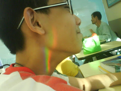 Shi peng's rainbow tattoo cause by light going through two prisms,