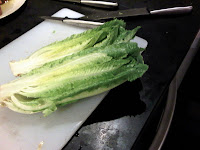 Slide romaine lettuce in two, lengthwise