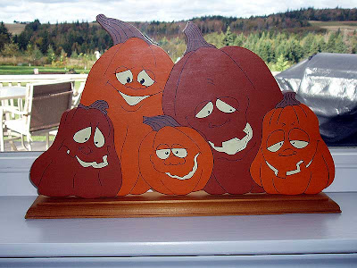 We made this happy pumpkin family years ago.