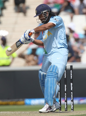 Ms Dhoni hitting the ball widescreen wallpapers