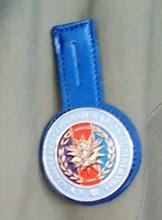 badge biru..
