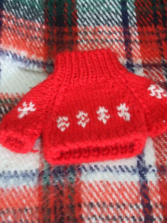 le pull rouge de kiki