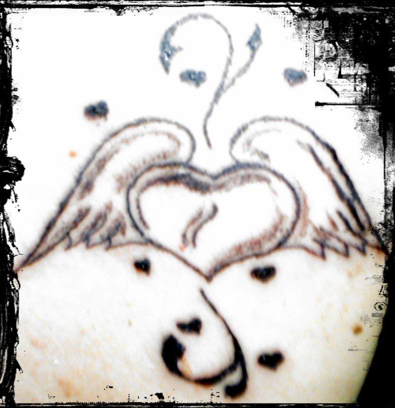 amarillo mikonkatu enkelin siivet tatuointi