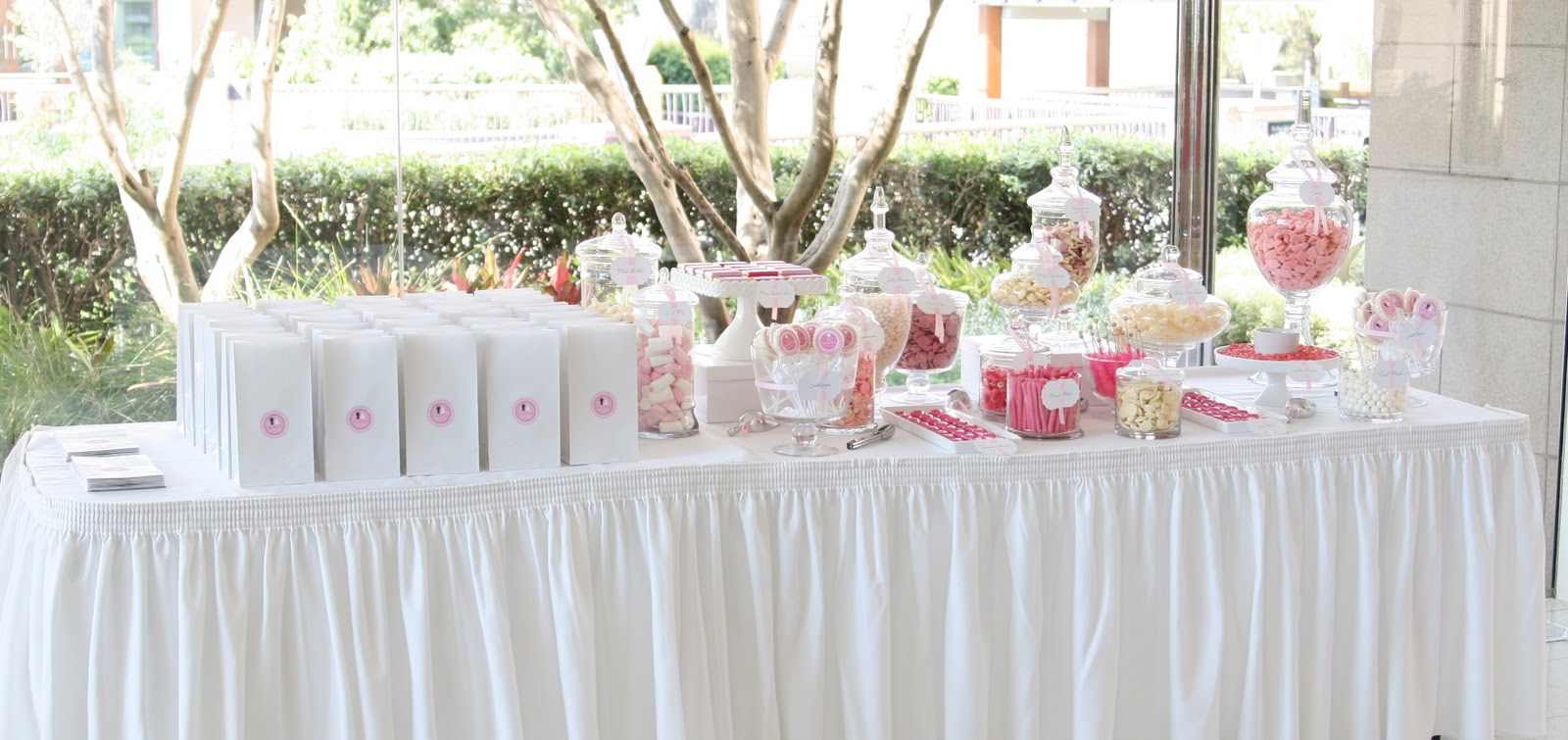 a pink and white wedding candy table sweet style