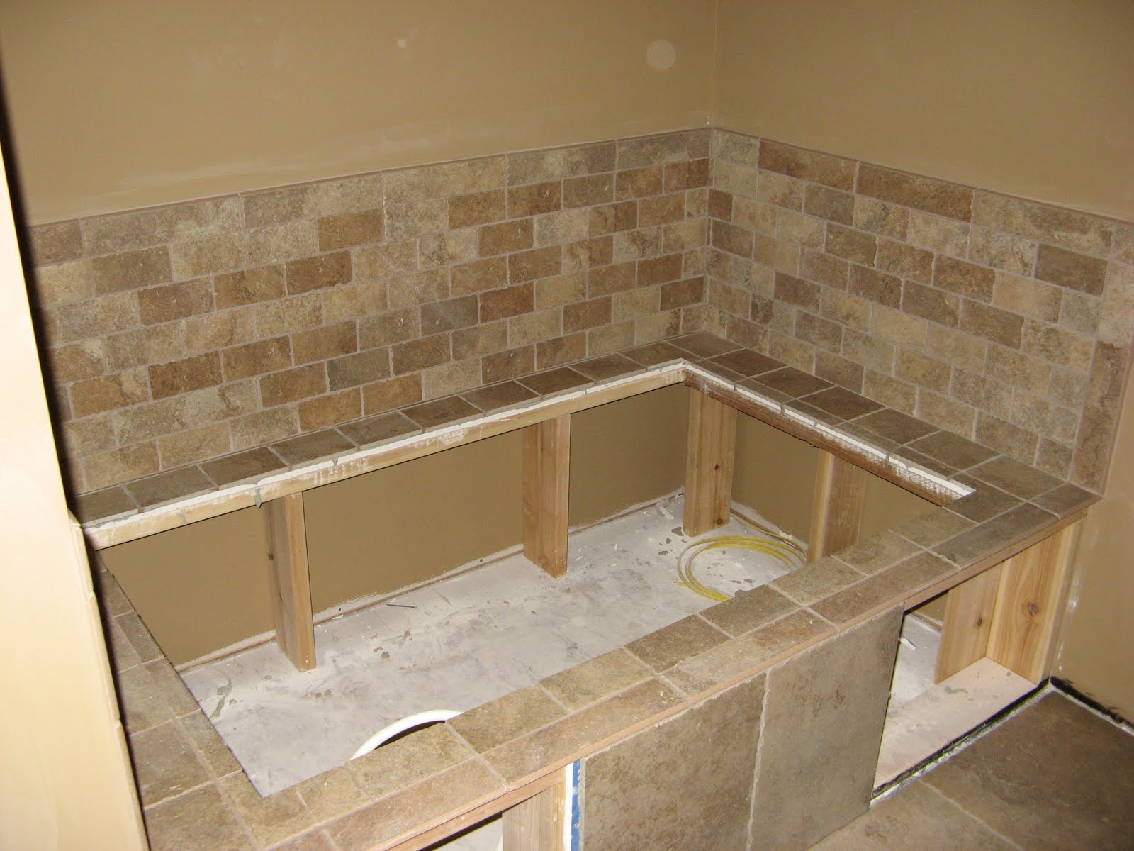 Tiling around bathtub - Installing tile around bathtub ...