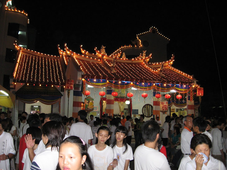 Buddhist devotees gather round the temple after the procession