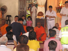Devotees offering robes etc to the monks