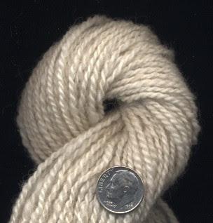 """Peeps"" a pale fawn Shetland lamb handspun."