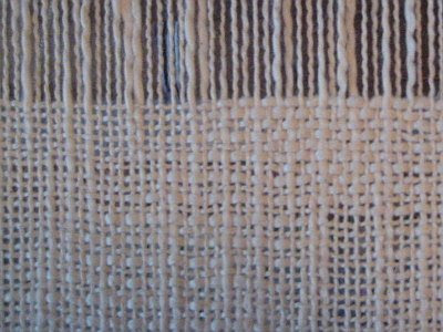 Plain weave with textured yarn.