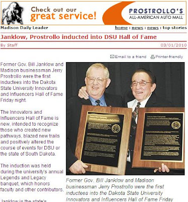 Former Governor Bill Janklow and Madison car dealer Jerry Prostrollo hug as they are inducted into the new DSU Hall of Fame -- photo from Madison Daily Leader 2010.03.01