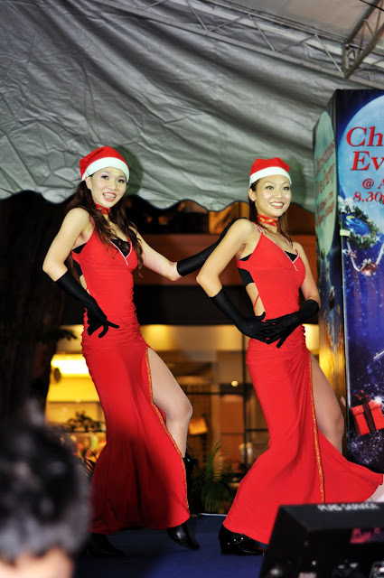 Christmas Eve Celebration Pretty Dancers in Red Dress Dancing
