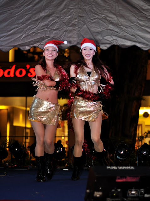 Dancers in golden costume performing at Christmas Eve Party Celebration