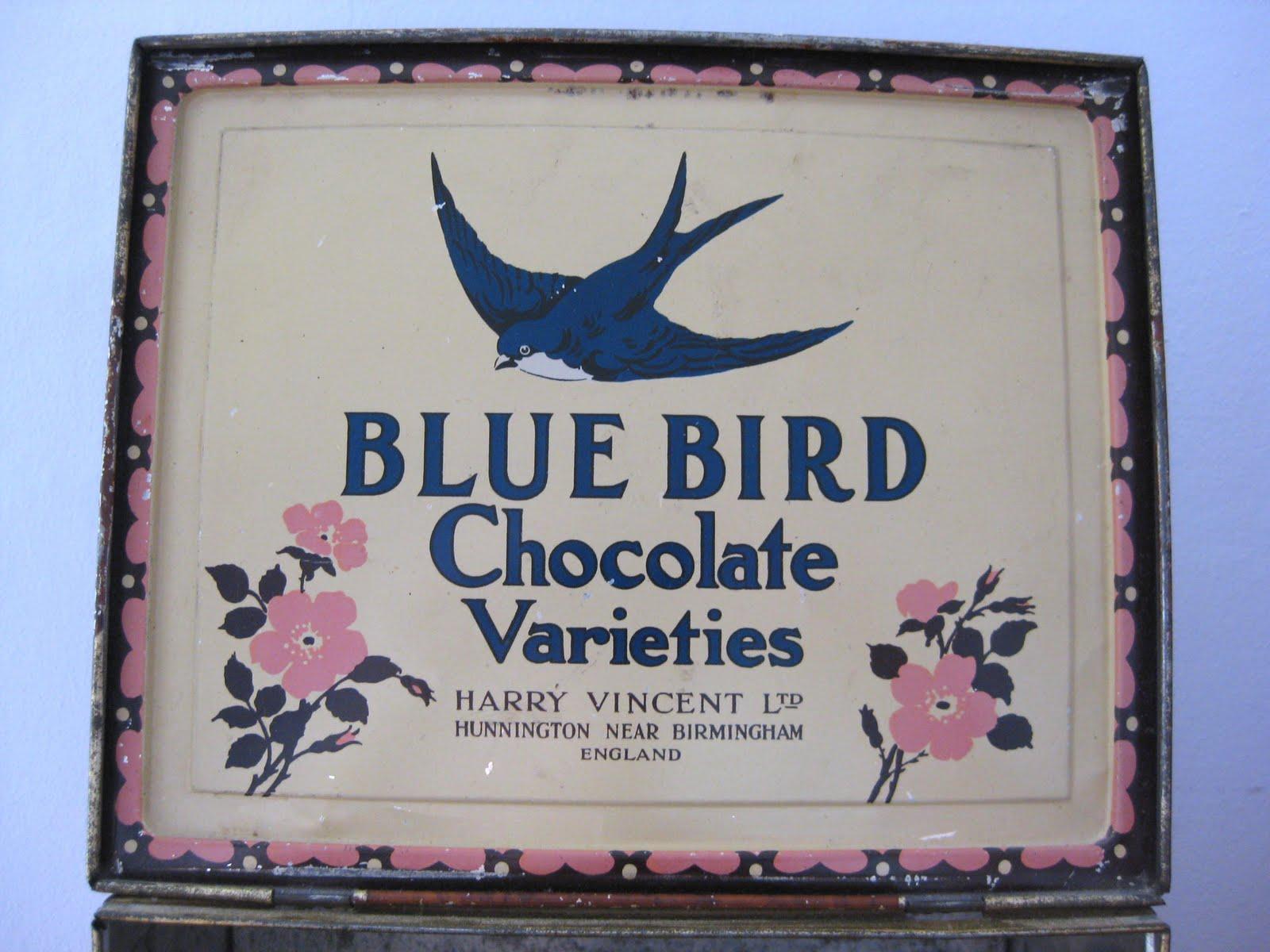 Vintage blue bird toffee tin village