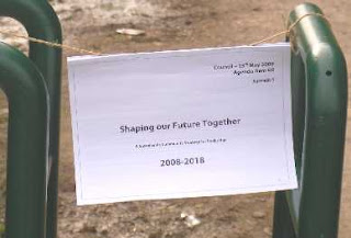 an attached sign saying shaping our future together
