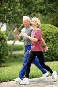 an 'older' couple power walking
