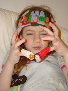 Cora with lots of hair clips on