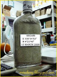 Pasir Panjang in a whiskey bottle