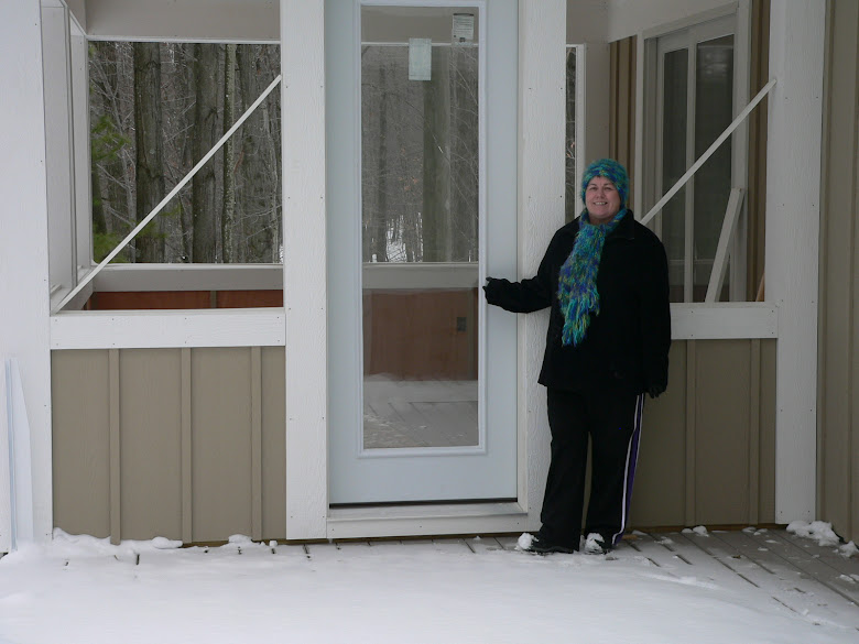Barbara showing off the new door to the porch