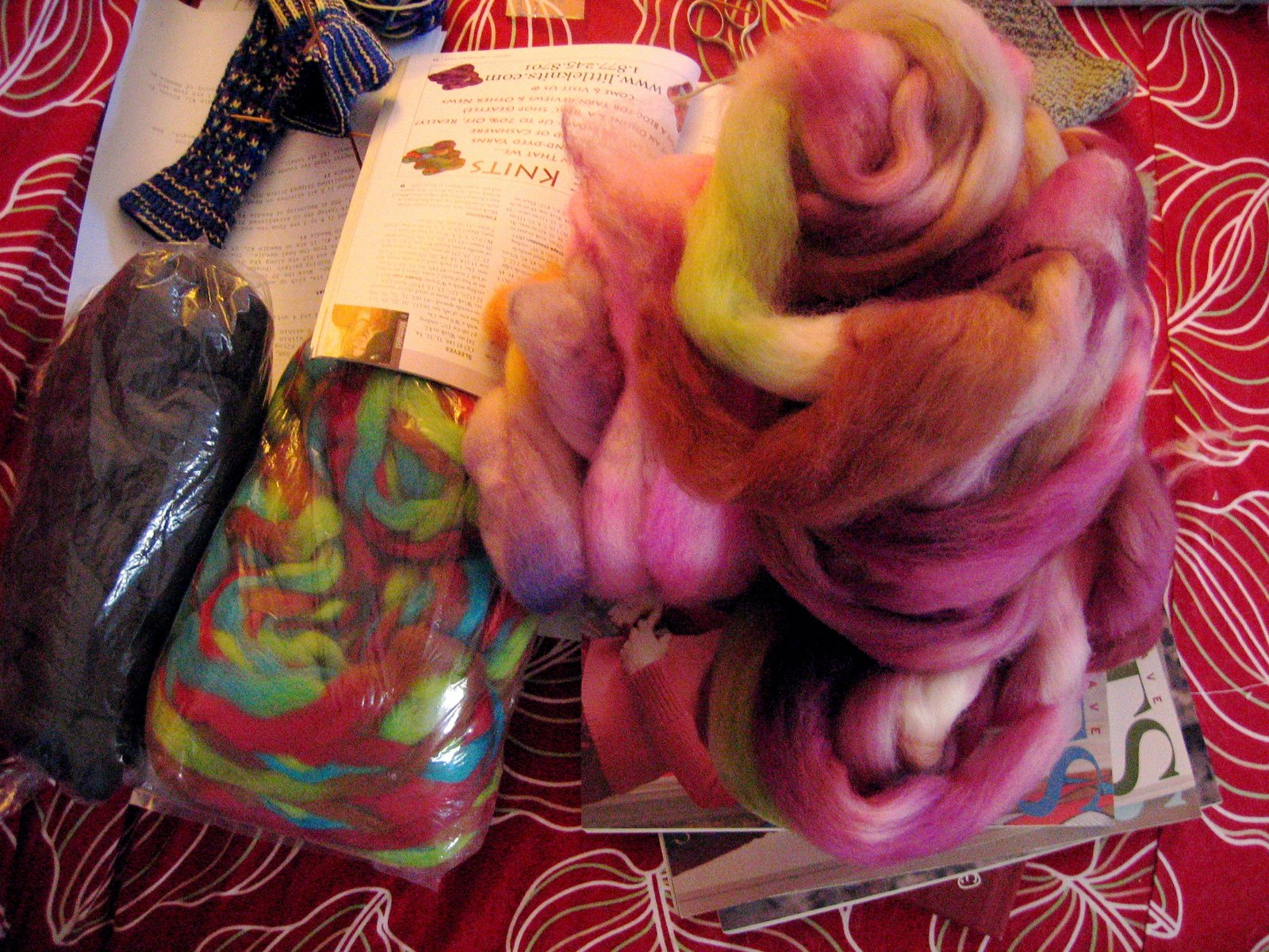 [It's+taking+over...+wool+roving+drafted+and+ready+for+knitting]
