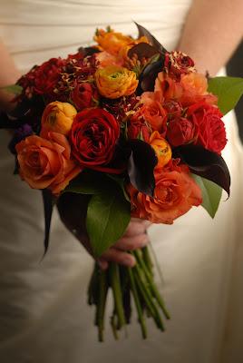roses, ranunculus and mini calla brides bouquet