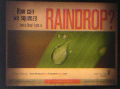 "Monsanto ad that reads ""How do you squeeze more food from a raindrop?"""