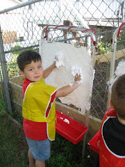 "Julian ""painting"" with shaving cream."