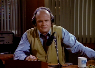 Frasier at his desk at KACL