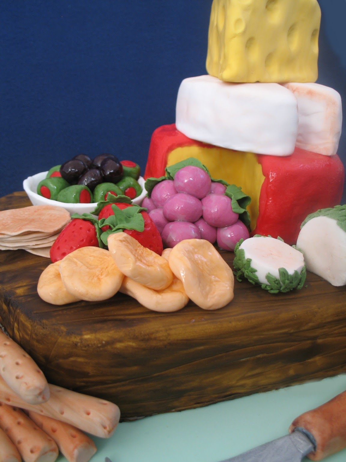 The cheese knife, bread sticks, dried apricots, strawberries, crackers ...