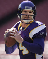 Brett Favre in a Vikings Jersey getting ready to pass