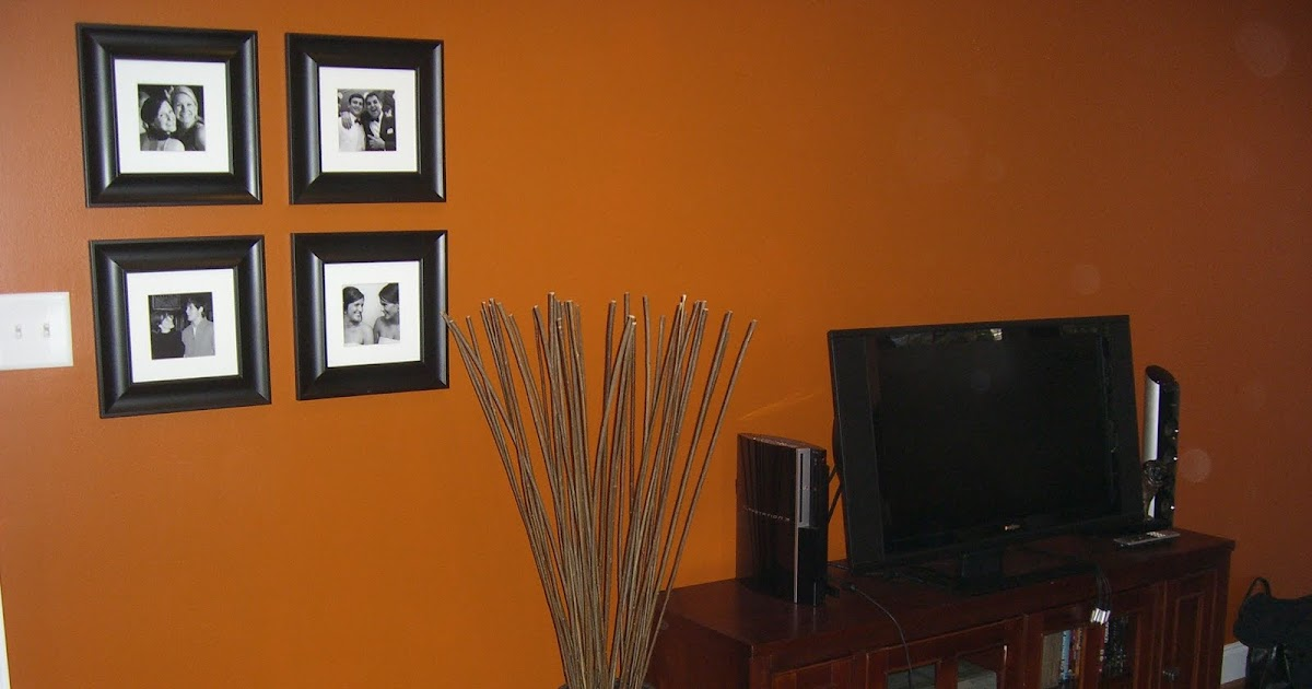 An inviting abode decorating chapel hill style - Burnt orange paint for living room ...