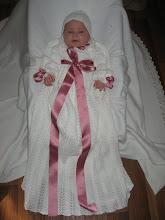 Dåpskjolen med rosa sløyfer