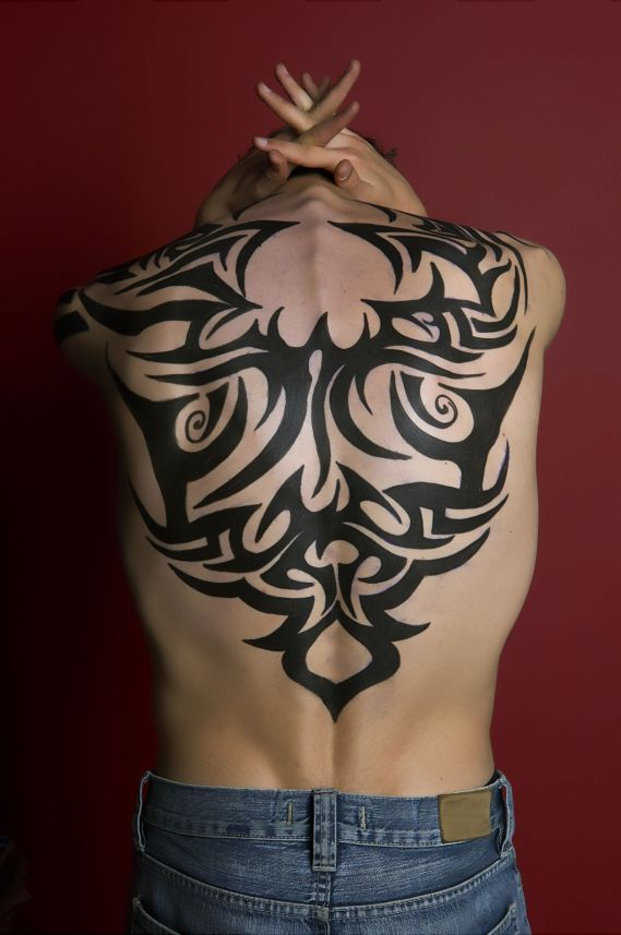 shoulder tribal tattoos and upper back tribal tattoos art designs is