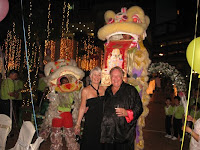 Sandie & Ted posing in front of the lion dance act
