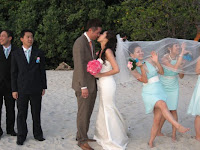 the bridal couple kissing by the beach