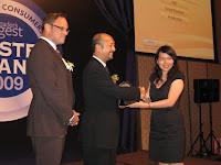 A representative receiving an award