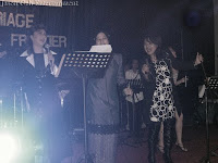 The other two professional wedding singers jamming with a guest singer