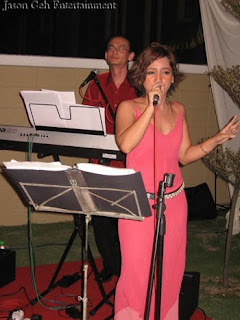 Female jazz singer backed by Jason Geh on keyboards